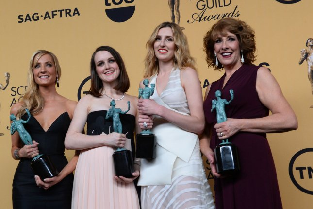 (L-R) Joanne Froggatt, Sophie McShera, Laura Carmichael and Phyllis Logan pose backstage with the award for outstanding performance by an ensemble in a drama series for Downton Abbey at the 21st annual SAG Awards held at the Shrine Auditorium in Los Angeles on Jan. 25, 2015. Photo by Jim Ruymen/UPI