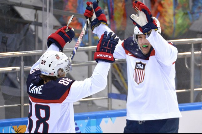 USA's James Van Riemsdyk (right) celebrates with teammate Patrick Kane. UPI/Kevin Dietsch