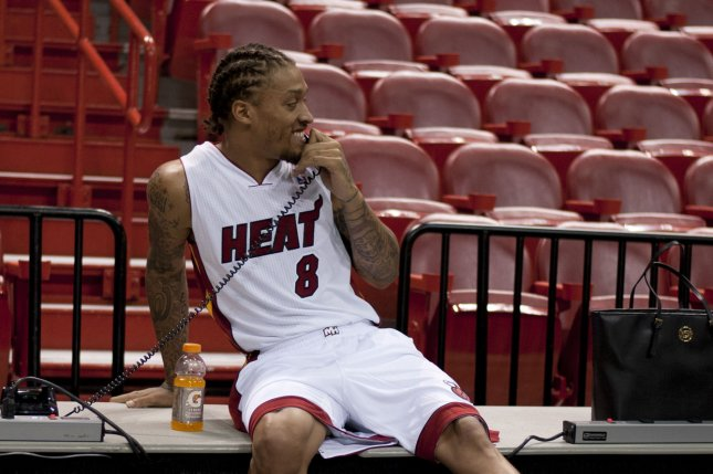 Former Miami Heat forward Michael Beasley (8) talks to a reporter during the team's media day at the American Airlines Arena in Miami, Florida on September 30, 2013. UPI/Gary I Rothstein
