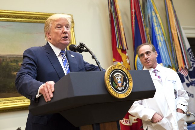 President Donald Trump speaks during a Department of Veterans Affairs announcement of a new program using video and software technology to provide medical care to veterans. Listening is Veterans Affairs Secretary Dr. David Shulkin. Photo by Chris Kleponis/UPI