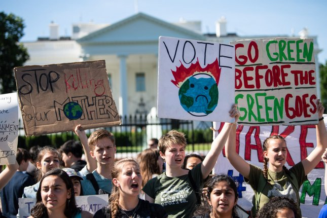 Activists take part in the Global Climate Strike Friday in front of the White House in Washington, D.C. Photo by Kevin Dietsch/UPI