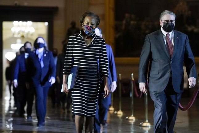 Clerk of the House Cheryl Johnson along with House Sergeant-at-Arms Tim Blodgett lead the Democratic House impeachment managers as they walk through Statuary Hall on Capitol Hill to deliver to the Senate the article of impeachment alleging incitement of insurrection against former President Donald Trump. Pool Photo by J. Scott Applewhite/UPI