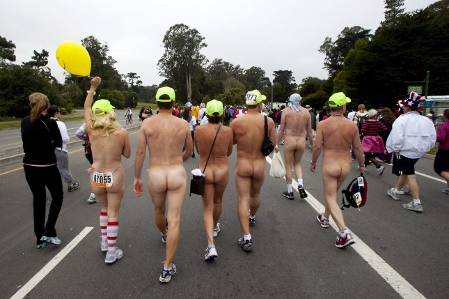 Naked runners enter Golden Gate Park during running of the 99th annual Bay to Breakers race in San Francisco on May 16, 2010. Hundreds braved the foggy chill to run the 12km race nude. UPI/Mohammad Kheirkhah