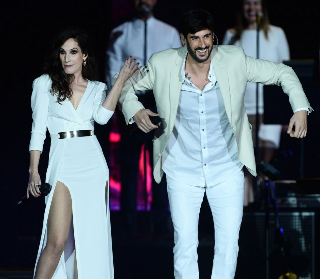 Recording artists Malu and Melendi perform onstage during the Latin Grammy Person of the Year Tribute to Brazilian singer/songwriter Roberto Carlos at the Mandalay Bay Convention Center in Las Vegas, Nevada on Nov.18. Photo by Jim Ruymen/UPI