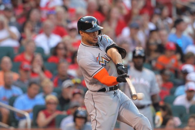 Miami Marlins' Giancarlo Stanton swings hitting into a double play against the St. Louis Cardinals in the fourth inning at Busch Stadium in St. Louis on July 16, 2016. Photo by Bill Greenblatt/UPI