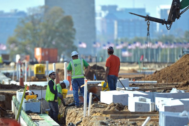 Laborers work at a construction site on the National Mall in Washington, D.C. The economy added 227,000 jobs in January, surpassing expectations. Among the strongest sectors was construction. File Photo by Kevin Dietsch/UPI