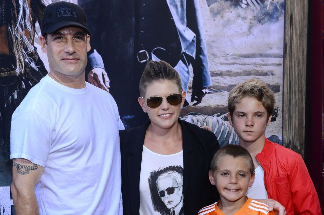 Adrian Pasdar (L), pictured with Natalie Maines and their sons, is seeking more than $60,000 per month in child and spousal support from the Dixie Chicks singer. File Photo by Jim Ruymen/UPI