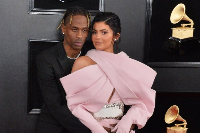 Kylie Jenner (R), pictured with Travis Scott, denied plastic surgery reports and rumors of her engagement to Scott in a new interview. File Photo by Jim Ruymen/UPI