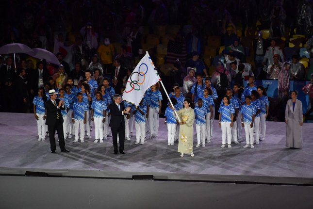 The Olympic flag is passed to the mayor of Tokyo, Japan, for the 2020 Olympic Summer Games during the closing ceremony in Rio de Janeiro, Brazil, on August 21, 2016. File Photo by Richard Ellis/UPI
