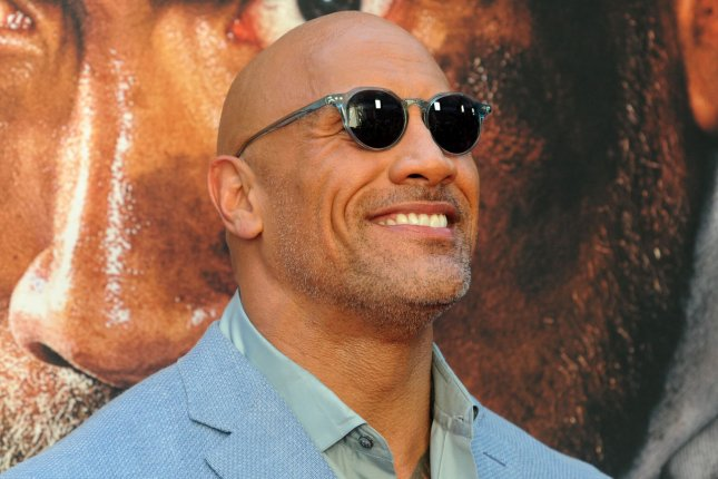 Dwayne The Rock Johnson -- one of the world's highest-paid actors -- is now part owner of the XFL. File Photo by Dennis Van Tine/UPI