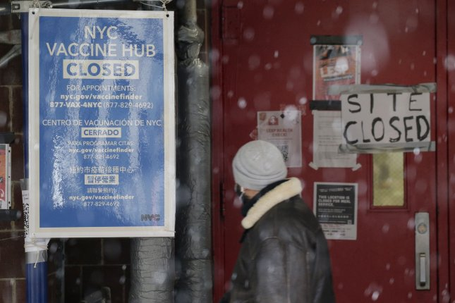 A closed sign is seen at a vaccination hub in New York City on Tuesday. New York expects to get more vaccine later this week. Photo by John Angelillo/UPI