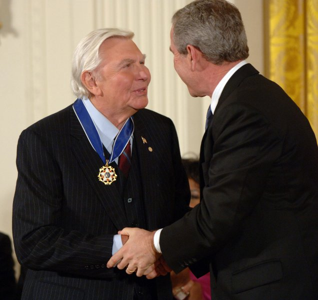 Former U.S. President George W. Bush shakes hands with actor Andy Griffith after Bush awarded him the Presidential Medal of Freedom during a ceremony in the East Room of the White House on Nov. 9, 2005. (UPI Photo/Roger L. Wollenberg)