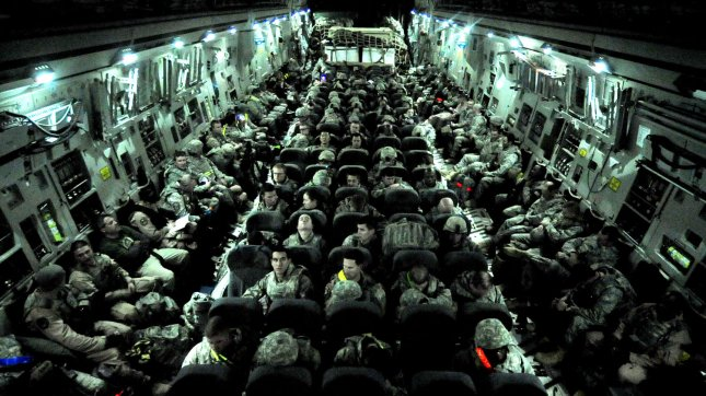 In This December 18, 2011 DOD Airmen of the 407th Air Expeditionary Group prepare to take-off on a C-17 Globemaster III cargo aircraft at Ali Air Base, Iraq. These airmen are the last service members to fly out of Iraq. The last remaining U.S. airmen left Iraq per the Iraq and U.S. 2008 Security Agreement that required all U.S. service members to be out of the country by Dec. 31, 2011. Since 2003, more than 1 million airmen, soldiers, sailors and Marines have served in Iraq. UPI/DOD