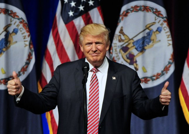 Donald J. Trump makes a campaign appearance in Ashburn, Va., on Tuesday. Trump announced he is endorsing House Speaker Paul Ryan after initially declining to do so. Photo by Ron Sachs/UPI