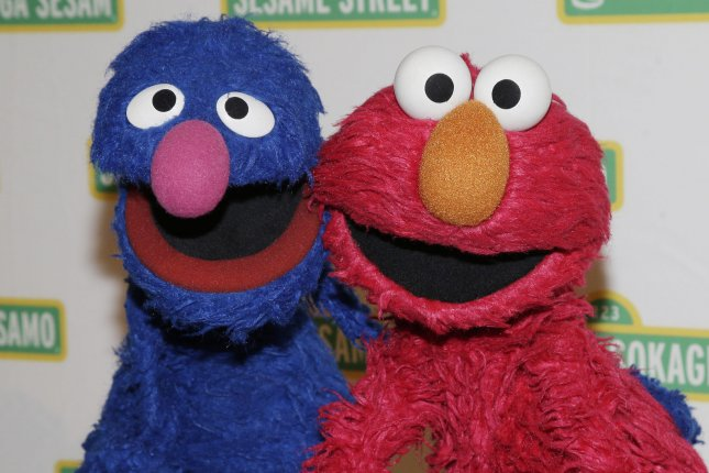 Sesame Street Muppet's Elmo and Grover stand on the red carpet at the Sesame Workshop's 13th Annual Benefit Gala at Cipriani 42nd Street in New York City on May 27, 2015. Sesame Workshop has announced plans to revamp their Elmo's World segemnt on Sesame Street. File Photo by John Angelillo/UPI