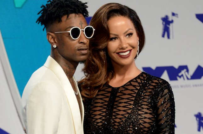 Amber Rose (R), pictured with 21 Savage, reacted to reports Tristan Thompson cheated on Khloe Kardashian. File Photo by Jim Ruymen/UPI