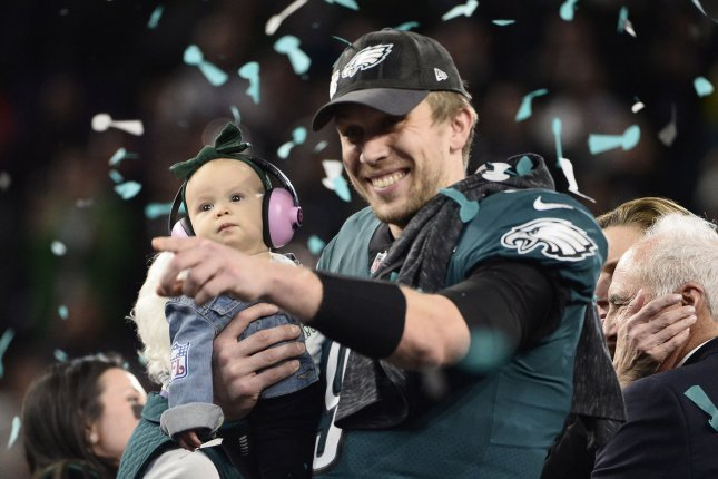 c705c8bdf60 Philadelphia Eagles quarterback Nick Foles holds his child as he celebrates  a 41-33 win over the New England Patriots during Super Bowl LII on February  4, ...