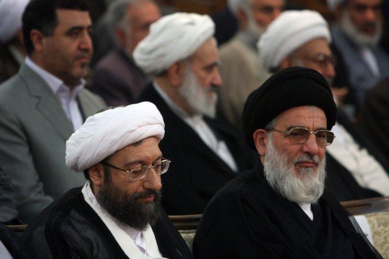 Iran's judiciary chief Sadeq Larijani (L) sits next to former judiciary chief Mahmoud Hashemi Shahroudi during his inauguration ceremony in Tehran on August 17, 2009. File Photo by Hoshang Hadi/ILA/UPI