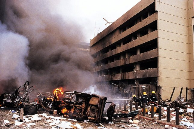 Fire and rescue workers are on the scene moments after a blast at the U.S. Embassy in the Kenyan capital early August 7, 1998, killed more than 40 people. Moments later, a second bomb exploded outside the U.S. Embassy in Dar Es Salam, Tanzania. UPI File Photo