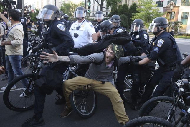 A man is detained by bicycle-mounted police near the White House during a demonstration to protest the Minnesota police killing of George Floyd on June 1, 2020, in Washington D.C. File Photo by Tasos Katopodis/UPI