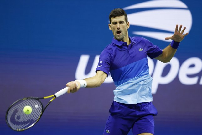 Novak Djokovic of Serbia hits a forehand to Alexander Zverev of Germany during their semifinals match inside Arthur Ashe Stadium at the 2021 U.S. Open Tennis Championships on Friday at the USTA Billie Jean King National Tennis Center in New York City. Photo by John Angelillo/UPI