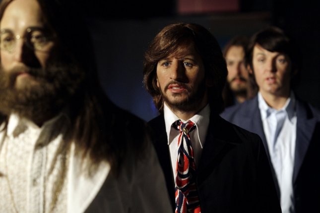 Wax figures John Lennon, Ringo Star, Paul McCartney and George Harrison of The Beatles are posed to recreate the Abbey Road album cover on McCartney's 70th Birthday at Madame Tussauds in New York City on June 14, 2012. UPI/John Angelillo