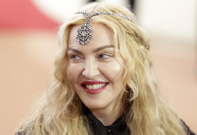 Madonna arrives on the red carpet at the Costume Institute Benefit at The Metropolitan Museum of Art celebrating the opening of Manus x Machina: Fashion in an Age of Technology in New York City on May 2, 2016. Madonna appeared at the MoMA on Wednesday to surprise fans who were watching a 25th anniversary screening of her 1991 documentary Madonna: Truth or Dare. File Photo by John Angelillo/UPI