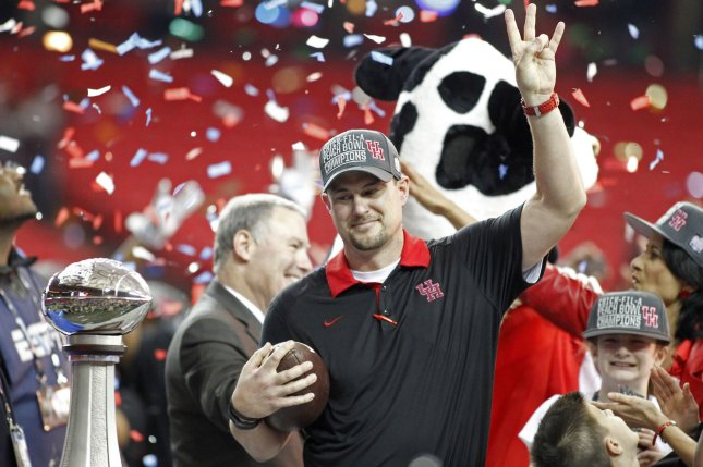 Houston Cougars head coach Tom Herman celebrates his 38-24 win over the Florida State Seminoles afterd the 2015 Chick-fil-A Peach Bowl at the Georgia Dome in Atlanta on December 31, 2015. Photo by Tami Chappell/UPI
