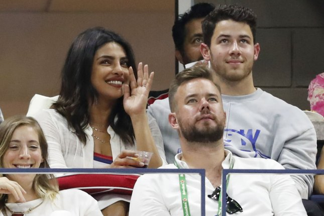 Married couple Priyanka Chopra (L) with Nick Jonas (R). Chopra appeared on The Tonight Show where she discussed marrying Jonas and how she is writing a memoir. File Photo by John Angelillo/UPI