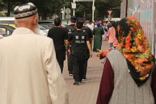 Han Chinese police patrol the streets during Ramadan in what many consider the Muslim capital of China, Urumqi, the capital of China's predominantly Muslim and restive Xinjiang Province. Photo by Stephen Shaver/UPI