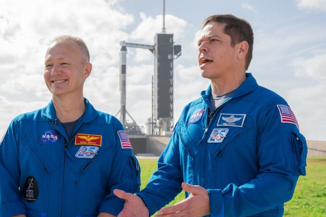 NASA astronauts Doug Hurley (L) and Bob Behnken stand near Launch Pad 39A at Kennedy Space Center in Florida in January during a dress rehearsal for a SpaceX Crew Dragon launch on May 27. File photo courtesy of NASA