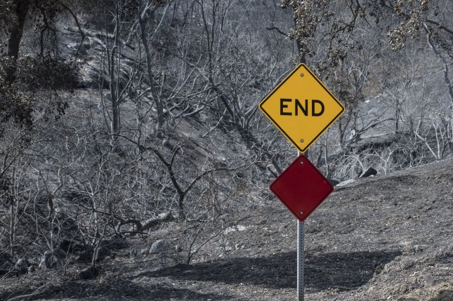 A burned out cul-de-sac is marked by a new sign along Pleasants Valley Road in Vacaville, Calif., on September 19. Photo by Terry Schmitt/'UPI