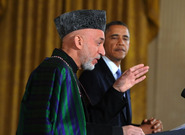U.S. President Barack Obama listens as Afghanistan President Hamid Karzai makes a point during a joint press conference in the East Room of the White House in Washington, DC on January 11, 2013. UPI/Pat Benic