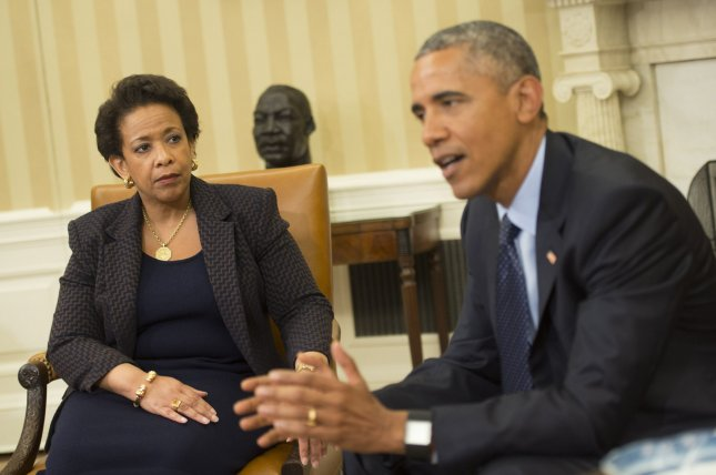 Attorney General Loretta Lynch watches as President Barack Obama speaks to the media on the need for the Senate to pass the U.S.A. Freedom Act, in the Oval Office at the White House on Friday. Photo by Kevin Dietsch/UPI