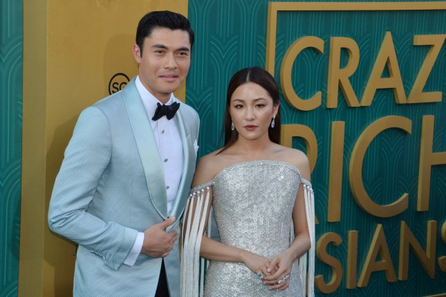 Henry Golding and Constance Wu's Crazy Rich Asians is the No. 1 movie in North America this weekend. File Photo by Jim Ruymen/UPI