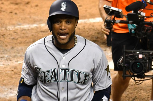Seattle Mariners batter Robinson Cano celebrates after hitting a solo home run. File photo by Gary I Rothstein/UPI