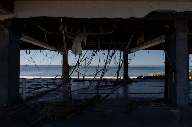 Damaged electrical wires hang from the ceiling of an apartment building in Mexico Beach, Fla., on October 13 after Hurricane Michael, which hit the Florida Panhandle as a Category 5 storm. File Photo by Ken Cedeno/UPI