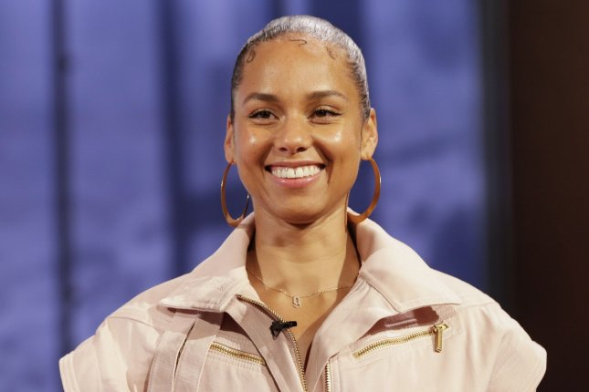 Alicia Keys will receive the American Express Impact Award at Billboard's Women in Music celebration Dec. 12 in Los Angeles. File Photo by John Angelillo/UPI