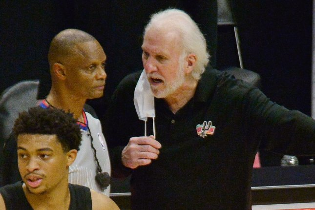 Coach Gregg Popovich (R) and the San Antonio Spurs have had their next three games postponed because of a COVID-19 outbreak within the team. File Photo by Jim Ruymen/UPI