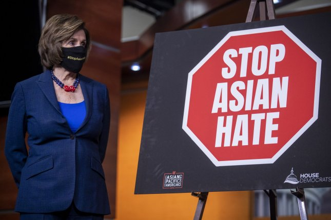 House Speaker Nancy Pelosi listens to remarks during a press conference about the COVID-19 Hate Crimes Act at the U.S. Capitol in Washington, D.C., on May 18. File Photo by Kevin Dietsch/UPI