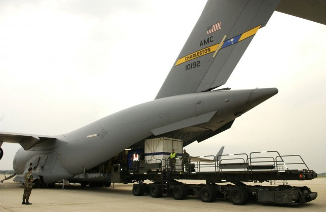 Air Force personnel prepare to load Deep Drone 8000 onto a C-17 Globemaster III at Andrews AFB on August 5, 2005. The U.S. Navy Supervisor of Salvage and Diving (SUPSALV) is deploying a Deep Drone 8000 Remotely Operated Vehicle (ROV), capable of operating at a depth up to 8000 feet. The Navy and Air Force are transporting Deep Drone in an effort to assist the rescue of seven Russian Sailors trapped on the ocean floor in a mini-submarine off the Kamchatka Peninsula. (UPI Photo/Christopher J. Matthews/Air Force)