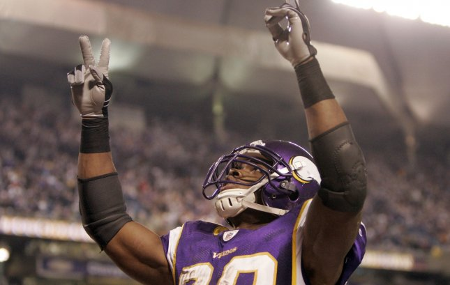 Minnesota Vikings running back Adrian Peterson (28) celebrates his second touchdown against the Philadelphia Eagles during the second quarter of their NFC Wild Card game at the Metrodome in Minneapolis on January 4, 2009. (UPI Photo/Mark Cowan)