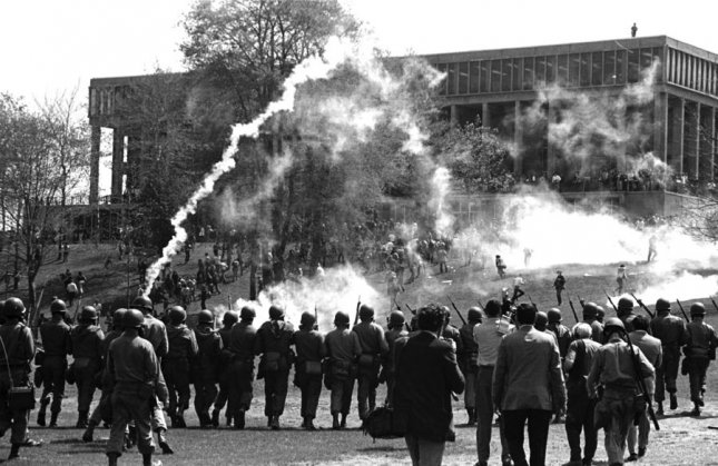 Tear gas is fired to disperse students gathered at Kent State May 4, 1970, to protest the war in Vietnam. cc/Photo courtesy of Kent State University Archives HO UPI