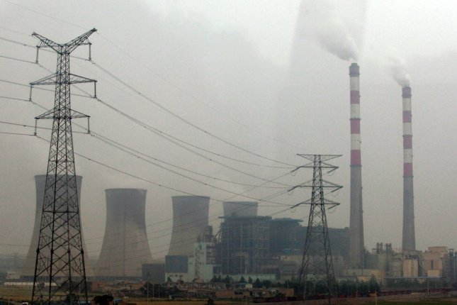 A power plant operates under heavy pollution in Xi'an, the capital of Shaanxi Province, on July 1, 2012. Leading respiratory disease specialists warn that air pollution could become China's biggest health threat and warns of dire consequences if the government fails to monitor and publicize the dangers of smog. UPI/Stephen Shaver