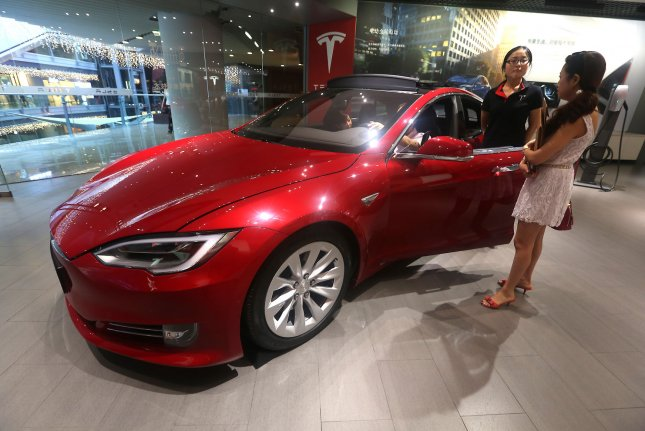 Tesla is working to win the race to produce the world's first self-driving car. Photo by Stephen Shaver/UPI