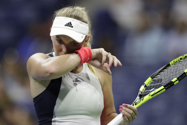 Caroline Wozniacki of Denmark removes sweat from her face between points in her defeat to Angelique Kerber of Germany in the semifinals in Arthur Ashe Stadium at the 2016 US Open Tennis Championships at the USTA Billie Jean King National Tennis Center in New York City on September 8, 2016. Photo by John Angelillo/UPI