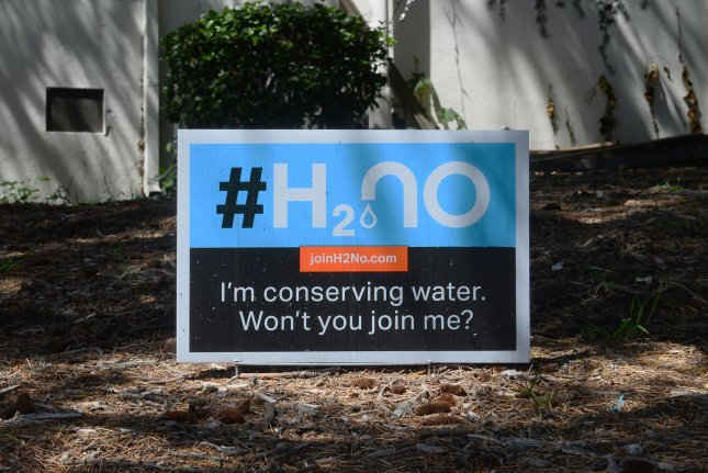 A sign in the the front yard of a home in the Silver Lake section of Los Angeles urges conserving water on April 2, 2015. An exceptionally rainy October in counties around the river has helped lift 12 percent of the state out of drought, but for the effects to spread to central and southern parts of California that are in much worse shape, exceptional amounts of rain will have to continue to fall this rainy season, which runs through February. File Photo by Jim Ruymen/UPI