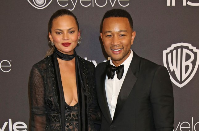 Chrissy Teigen (L) and John Legend at the InStyle and Warner Bros. Golden Globes after-party on January 8. File Photo by David Silpa/UPI