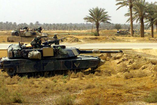 U.S. M1A1 Abrams tanks, part of Charlie Company, 1st Tank Battalion, maintain a defense position north of the intersection of Highway 1 and 27 in Iraq on April 1, 2003. The U.S. State Department recently approved a potential sale of M1A1 tanks to Kuwait. File Photo by Rex Features/UPI