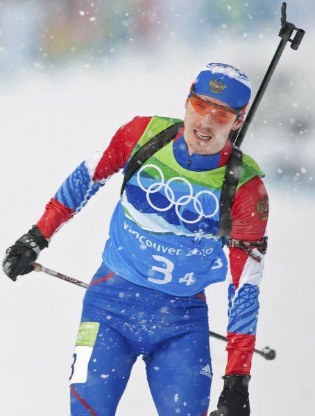 Russia's Evgeny Ustyugov wins bronze as he anchors his team across the finish in Biathlon Men's 4x7.5 KM Relay during the Vancouver 2010 Winter Olympics at the Whistler Olympic Park on February 26, 2010. Ustyugov was stripped of his 2014 Olympic gold medal Saturday. File Photo by Heinz Ruckemann/UPI